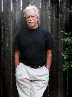 Kevin Clark Portrait in Black Shirt, Full Shot, Vertical, Outdoors
